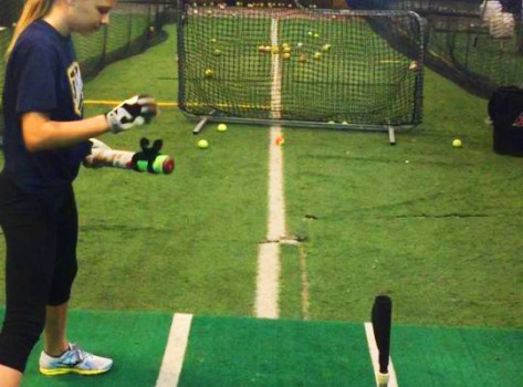 Softball swing training device